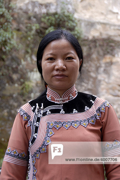 Portrait  ethnology  woman of the Hani ethnic group  self-made clothes  Xinji  Yuanyang  Yunnan Province  People's Republic of China  Asia
