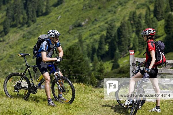Mountain bikers talking  Alpbachtal  North Tyrol  Austria  Europe