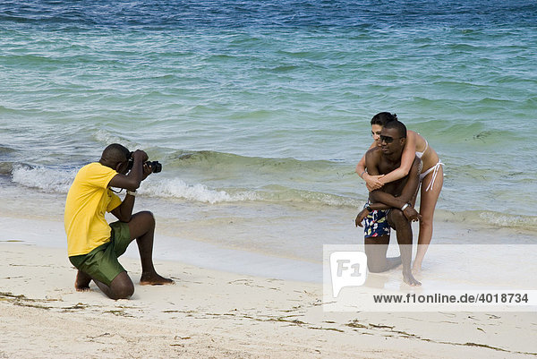 Photographer taking a picture of a couple on a beach  Punta Cana  Dominican Republic  Central America