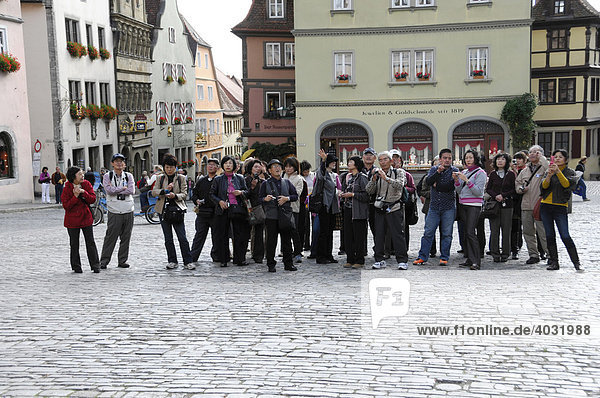 Group of Japanese tourists  Europe in 3 days  Rothenburg ob der Tauber  Bavaria  Germany  Europe
