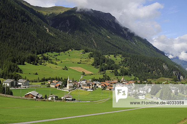On the Albula stretch with the Rhaetische Bahn RhB Railway on the famous sweep above Berguen  view of the village of Berguen  Graubuenden  Switzerland  Europe