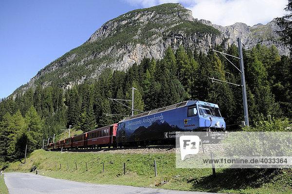 A passenger train of the Rhaetische Bahn RhB Railway travelling on the stretch between Berguen and Preda  Graubuenden  Switzerland  Europe