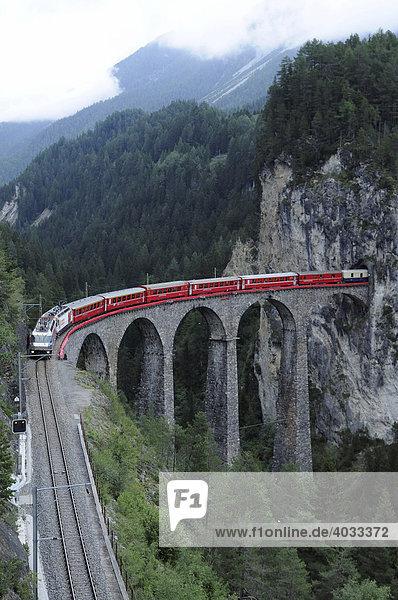 RhB  Rhaetian Railway train crossing the Landwasser Viaduct near Filisur  Albula section  Filisur  Graubuenden  Switzerland  Europe