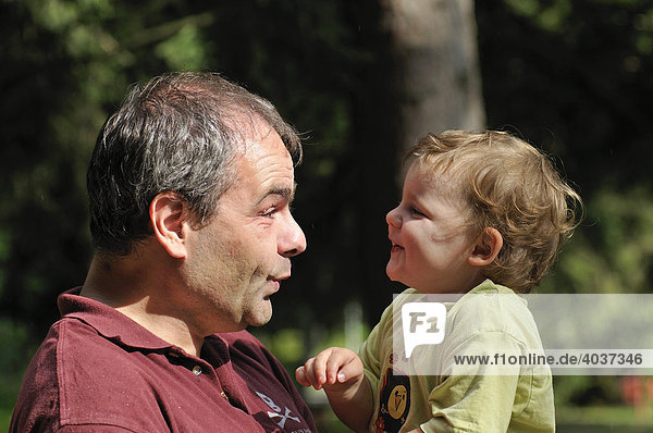 Father  40 years old  playing with his 2-year-old daughter