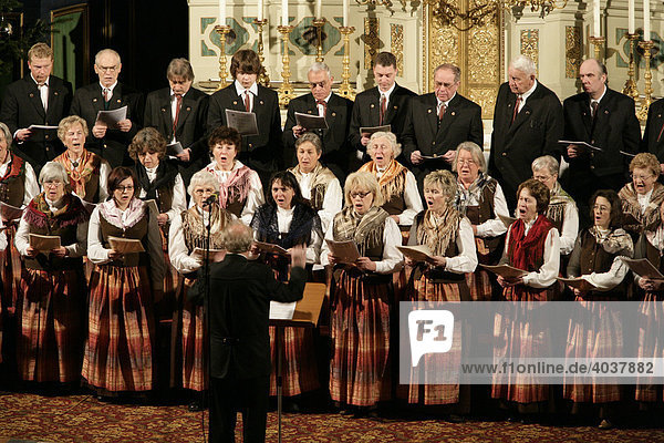Choir  singing during an advent choral concert in St Anns Basilica  Altoetting  Upper Bavaria  Germany  Europe