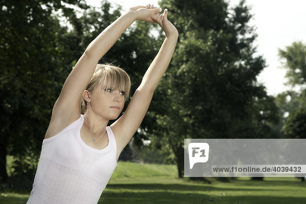 Young  dark blond woman stretching