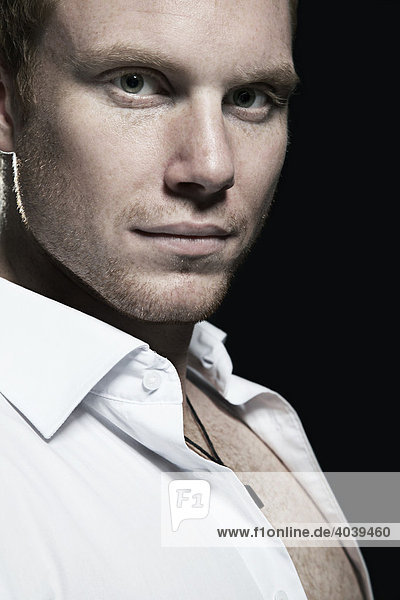 Portrait of a young man wearing a white shirt