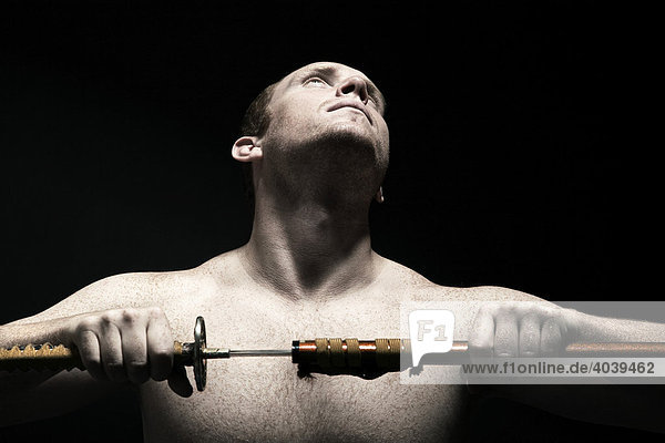 Man with a sword  preparing for a fight