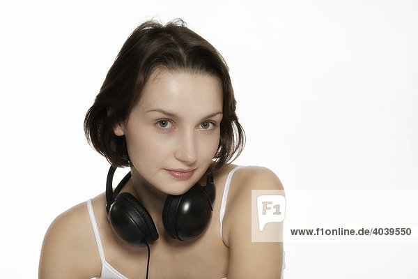 Young brunette woman with headphones  portrait