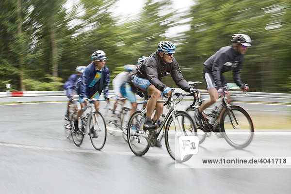 Cyclists in the rain during the Deutschland Tour 2008 cycling race  mountain stage after Winterberg  Sauerland  North Rhine-Westphalia  Germany  Europe