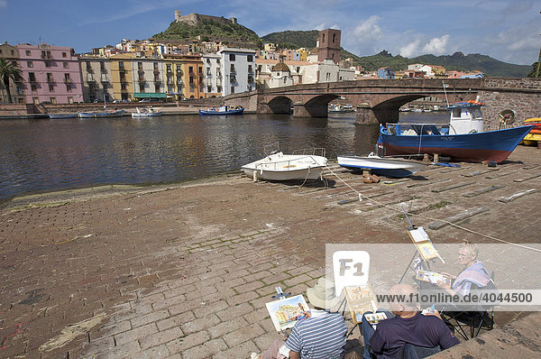 Painter on the bank of the Telmo River in Bosa  Sardinia  Italy  Europe