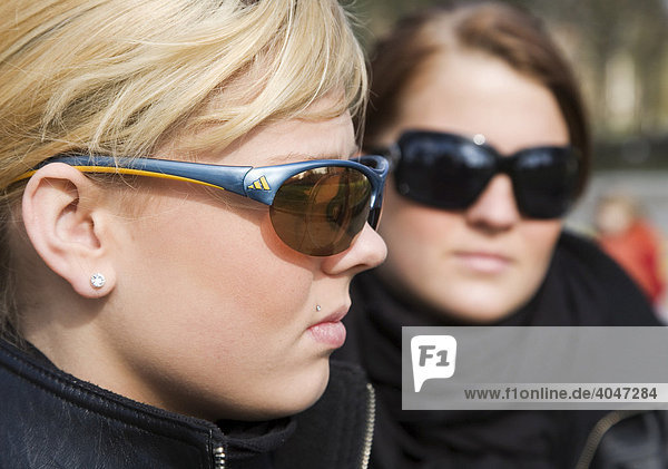 Two teenagers  15 years old  posing with sun glasses  Berlin  Germany  Europe