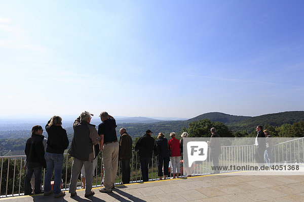 People on terrace on Kahlenberg mountain with panomaic view over Vienna  Austria  Europe