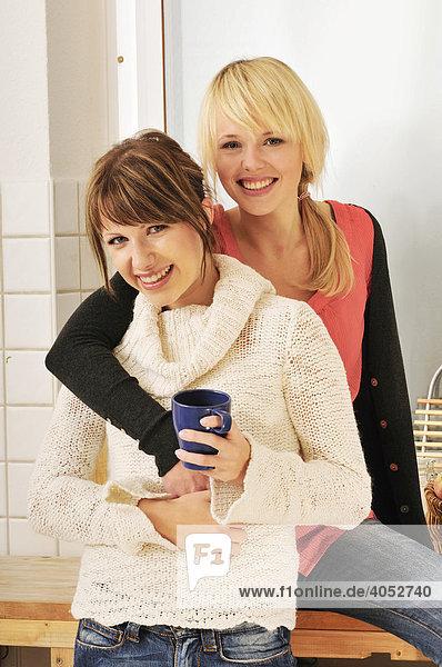 Two young women having a coffee break