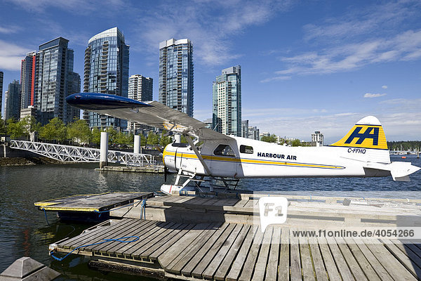Seaplane tied to jetty  at back the high-rise buildings of Coral Harbour  Vancouver  British Columbia  Canada  North America
