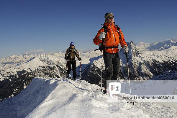 Ski hikers on a tour to the peak of Mount Brechhorn  view of Mount Rettenstein  Spertental Valley  Tyrol  Austria  Europe