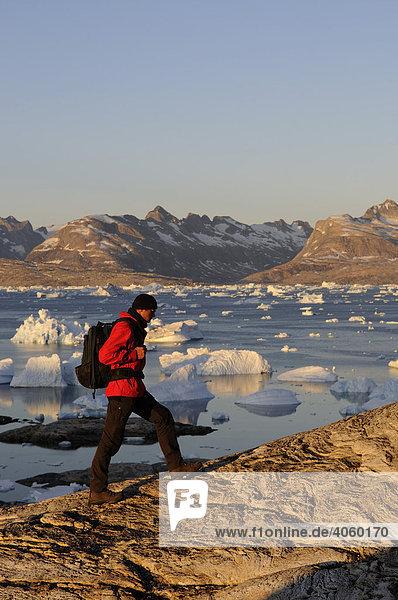 Hiker  trekking in the Sermilik-Fjord  East-Greenland  Greenland