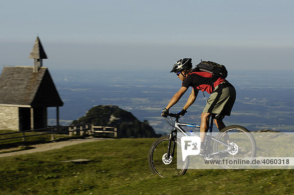 Mountain biker on Kampenwand  Chiemgau  Bavarian Pre-Alps  Bavaria  Germany  Europe