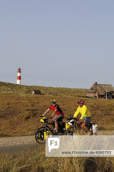 Cyclists in front of the Ostellenbogen Lighthouse  Sylt  North Frisia  North Sea  Schleswig-Holstein  Germany  Europe