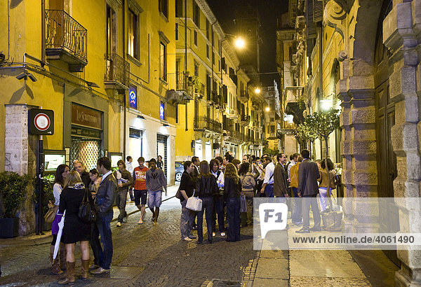 Youth gathered outside a pub in the historic centre of Verona  Italy  Europe
