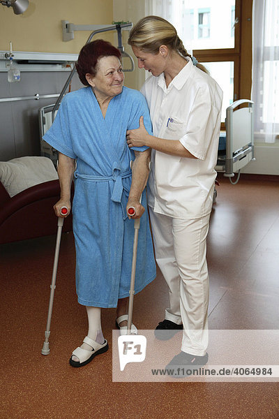 Physiotherapist supporting a patient