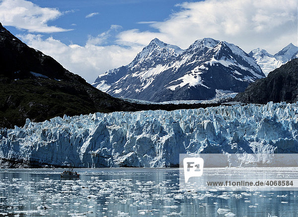 Fjord  edge of a glacier and a ship  Alaska  USA
