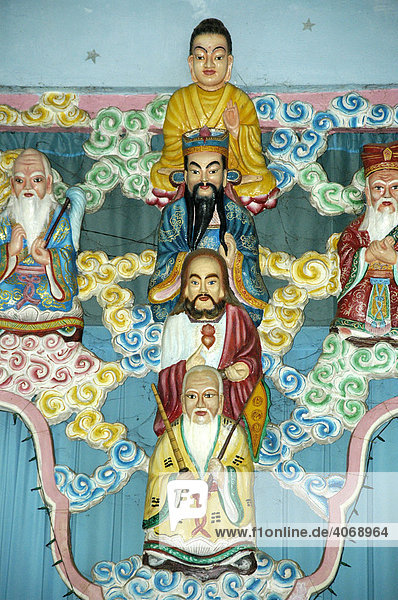 Colourful figures of Buddha  Mohammed and Jesus Christ in the Cao Dai Temple in Go Dao near the city of Ho Chi Minh  Saigon  Vietnam  Southeast Asia