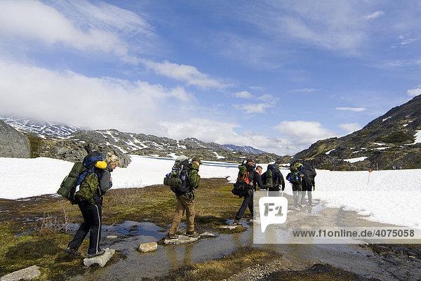 Group of alpinists walking through water  Chilkoot Pass/Trail  Klondike Gold Rush  British Columbia  B.C.  Canada  North America