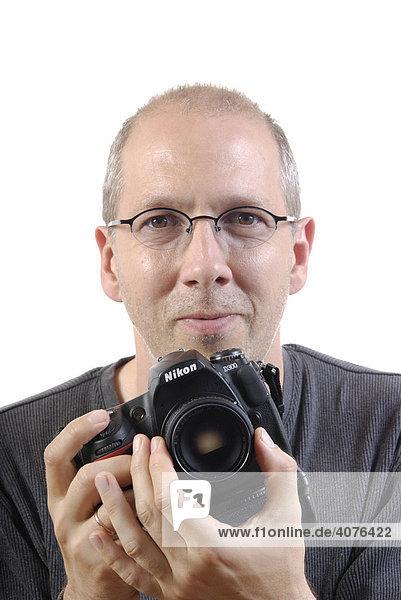 Photographer with a digital single-lens reflex camera