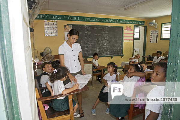 A teacher and students in a classroom at St. Peter's Elementary School  San Pedro  Belize  Central America