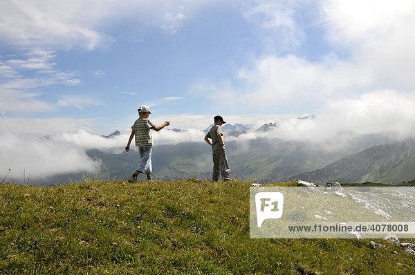 Two children  seven and eight years old walking  Nebelhorn  Allgaeu Alps  Bavaria  Germany  Europe