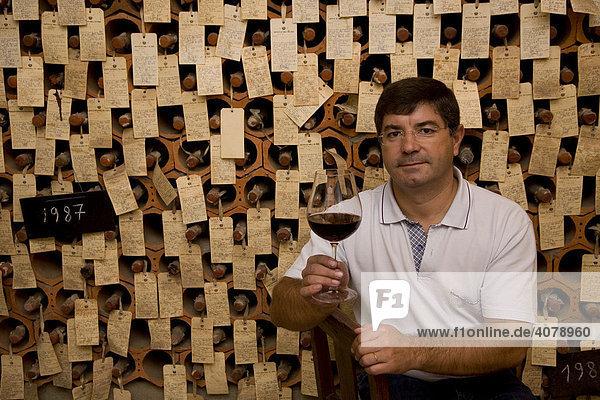Oenologist  Oscar Gato  in the bodega  wine cellar  where all of the sample bottles of the exporter are stored  Adega Cooperativa de Borba  Alentejo Region  Portugal  Europe