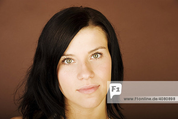 Young dark-haired woman looking serious