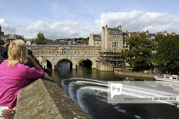 Pulteney Bridge flanked by shops across the River Avon  Bath  Wessex  England  UK