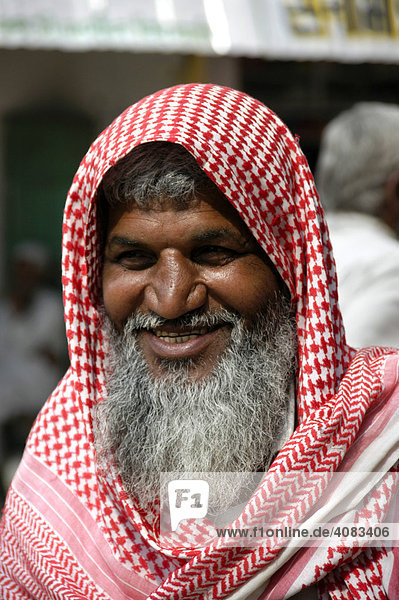 Portrait old man with a long gray beard wearing a red white kerchief Lachmangarh Rajasthan India