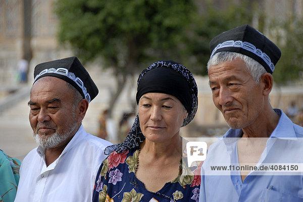 Uzbeks dressed in traditional cloth Samarkand Uzbekistan