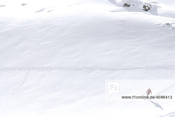 Lonely skier in the deep snow