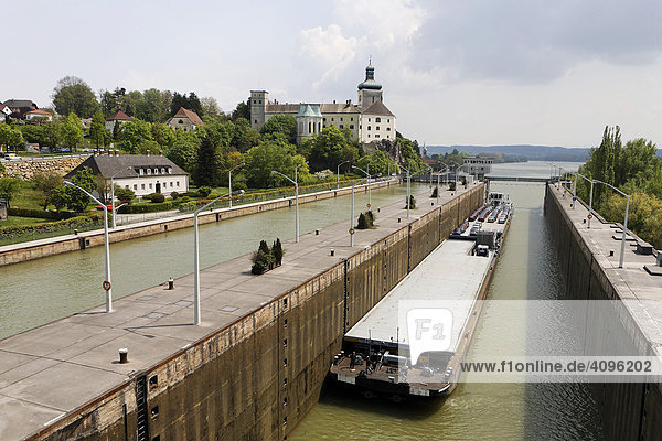 A freight ship in the water gate of the water power plant  Ybbs Persenbeug  Lower Austria  Austria