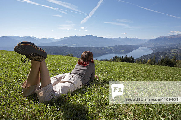 Woman on a meadow  Millstaetter See (Lake Millstatt)  Carinthia