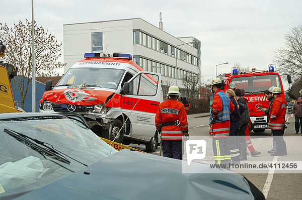 Traffic accident  VW Golf crashed into an ambulance that the driver failed to see  Golf visible in front of ambulance being pulled onto the tow-truck  Esslingen Region  Baden-Wuerttemberg  Germany  Europe