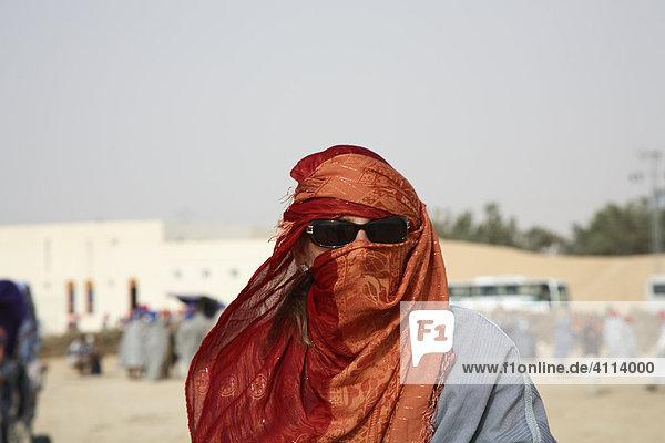 Tourist in Arabian clothes  Douz  Tunisia