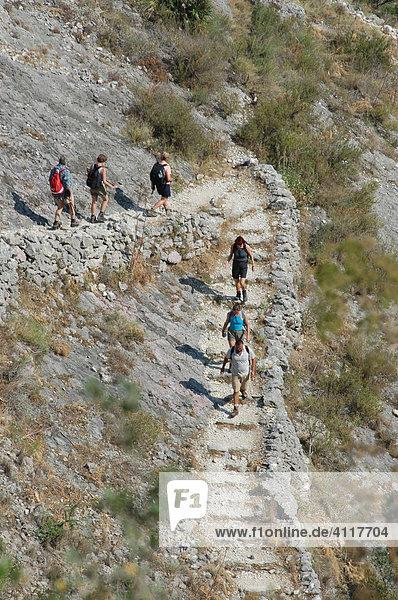 Hiking group on the 5000 Steps Moorish hiking trail between Fleix and Benimaurell  Costa Blanca  Spain  Europe