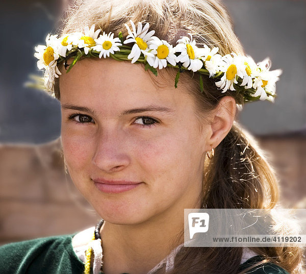Portrait of girl dressed in traditional clothing at a medieval marketplace in Tallinn  Estonia  Europe