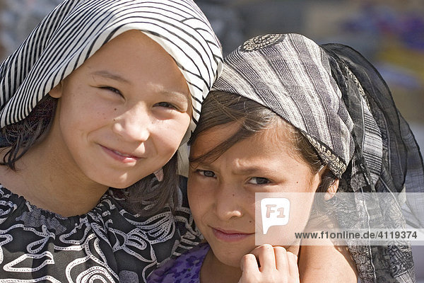 Asia  china  two chinese girls in khotan at silkroad.