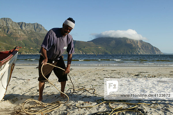 Fisher at the beach  Hout Bay near Cape Town   South Africa  Africa