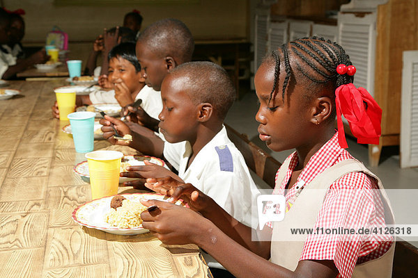 Shared meal at a daycare centre  New Amsterdam  Guyana  South America