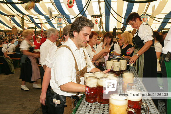 Attendees and wait staff in a beer tent at an international festival for national costume  Muehldorf  Upper Bavaria  Bavaria  Germany  Europe