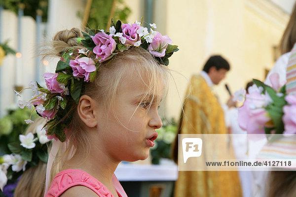 Child during the Corpus Christi procession  Muehldorf am Inn  Upper Bavaria  Germany  Europe