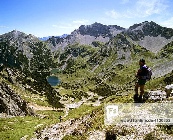 Hiker  view of lakes and the Soiernspitze peak  Karwendel Range  Kruen  Upper Bavaria  Bavaria  Germany  Europe