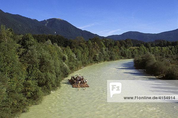Raft travelling down the Isar River near Lenggries  Upper Bavaria  Bavaria  Germany  Europe